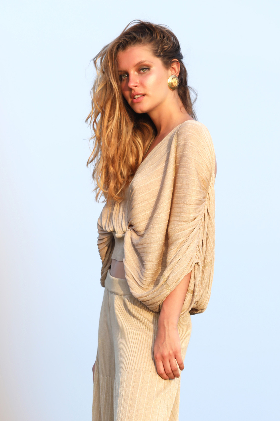 Pleated knit wrap blouse